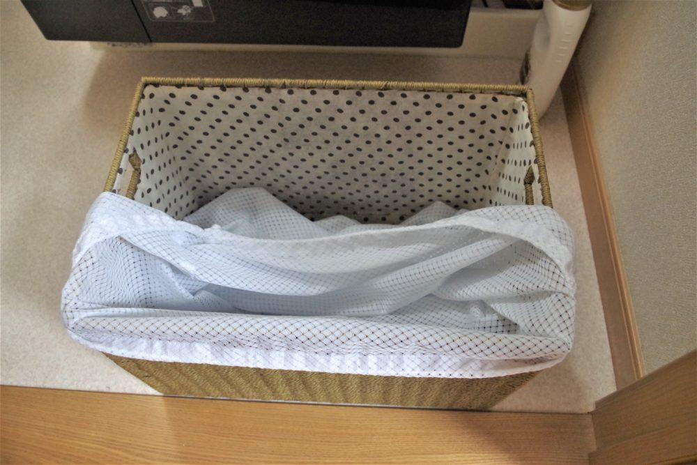 洗濯カゴにネットを張ろうとした