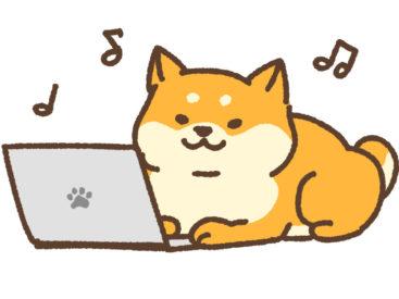 パソコンで文字を打つ犬のイラスト