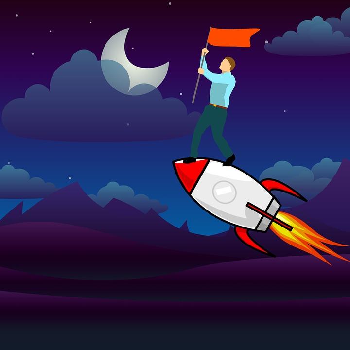 旗を持ってロケットに乗っている男性
