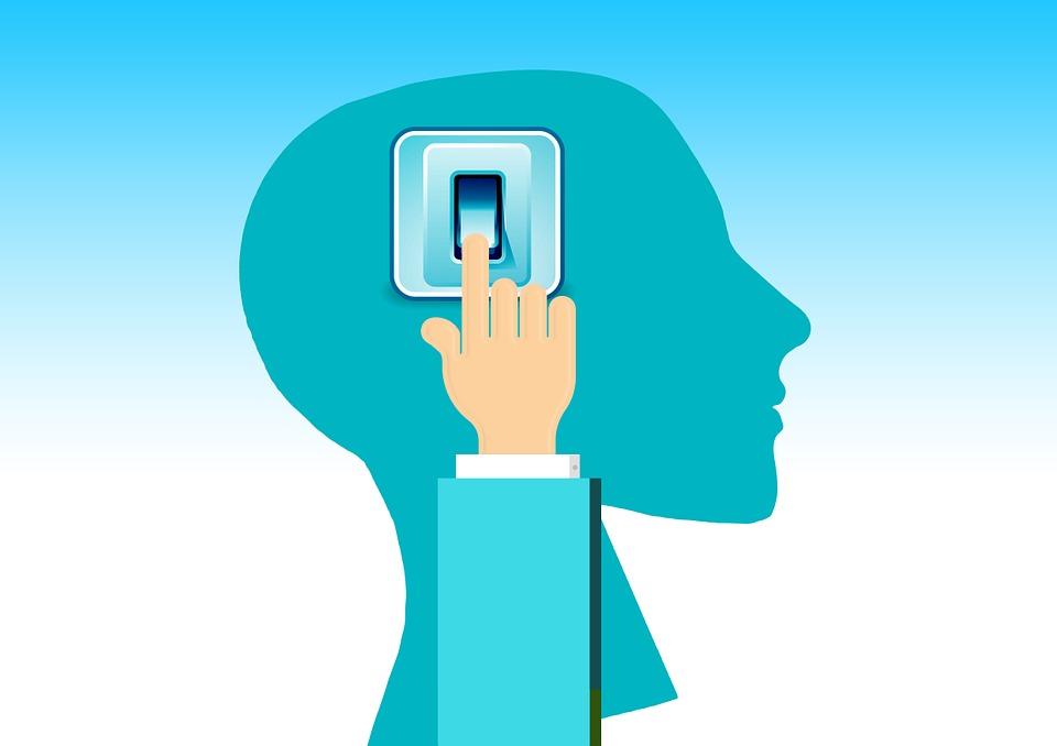 脳のやる気スイッチを押す手の画像