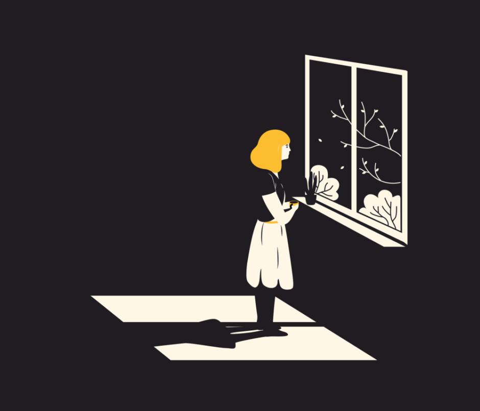 家の中で窓を眺める少女